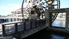 Renovated watermill stands in a park on the waterfront Malacca River Stock Footage