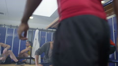 4K Cheerful sports players or gym buddies chatting together in men's locker room - stock footage