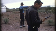 Men Shooting Gun Pistols Target Practice 1970s Vintage Film Home Movie 8211 Stock Footage