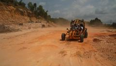 Racing the buggy on the sand, buggy competition in the desert Stock Footage