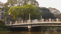 River, bridge and traffic in an Asian country Stock Footage