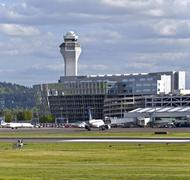Stock Photo of Portland Oregon International airport tower and facility with aircrafts.