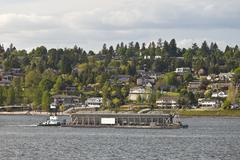 Barge pushing its cargo in the Columbia river Oregon. - stock photo
