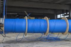 Blue ftp ethernet cable reels - stock photo