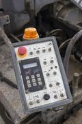 Control panel of asphalt paving machine Stock Photos