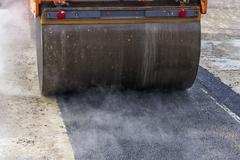 Detail of road roller during asphalt patching works Kuvituskuvat
