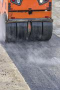 Detail of road roller during asphalt patching works - stock photo