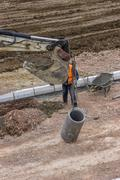 Installing storm drain system - stock photo