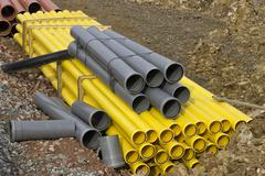 Stacks of colored pvc pipes Stock Photos
