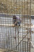 Worker adding the rebar for support Stock Photos