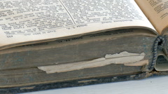 closing a holy bible - stock footage