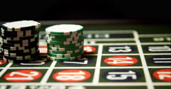 Croupier Putting Chips on Roulette - stock footage