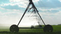 Automated Farming Irrigation Sprinklers System in Operation onField Stock Footage