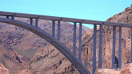 Stock Video Footage of 4K UHD Hoover Dam memorial bypass bridge light traffic low angle