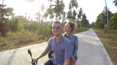 Happy Young Love Couple on Scooter Enjoying Summer Stock Footage