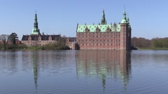 Frederiksborg Castle on a sunny spring day Stock Footage