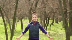 Girl doing stretching warming up before exercise in the woods Stock Footage