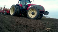 Tractor and seed drill in the field Stock Footage