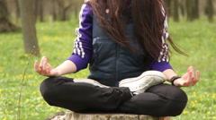 Forest, girl sitting on a stump in the lotus position  Yoga Stock Footage