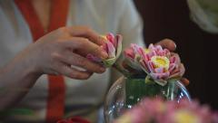 Woman preparing bouquet of lotus, ekibany Stock Footage
