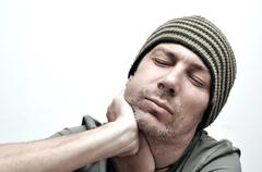 Young man suffering from toothache, teeth pain, having a swollen face Stock Photos