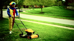 Clown using lawn mower Stock Footage