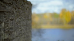 Autumn, river and fieldstone wall. Stock Footage