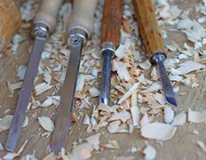 Chisels with wood chips after processing Stock Photos