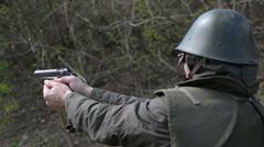 Man firing pistol Stock Footage