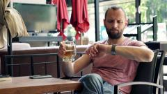 Young impatient man waiting for someone in cafe HD - stock footage