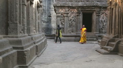 Tourists walking out of the rooms of Aurangabad caves. Stock Footage