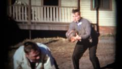 (1950's 8mm Vintage) Guys Playing Football in Front Yard in Dress Clothes Stock Footage