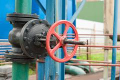 Cast iron valve on the water line. Stock Photos