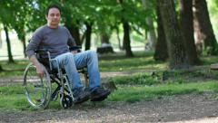 Man moving on a wheelchair Stock Footage