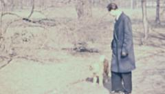 East Germany 1964: young man playing with his dog - stock footage