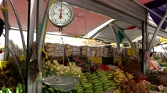 Curacao Willemstad 037 a pair of scales on fruit stall of floating market Stock Footage