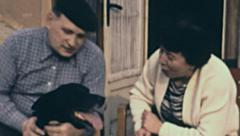 East Germany 1960's: couple of mature people petting their dog - stock footage