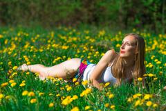 Sensual woman in a flowery meadow Stock Photos