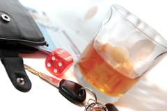Stock Photo of whiskey keys dice and euros