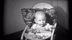 (1940's 8mm Vintage) Baby Bouncing in Chair - 3 Clips Stock Footage
