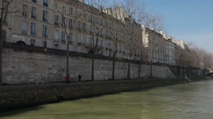 Along the Seine River establishing shot  - Vehicle shot - stock footage