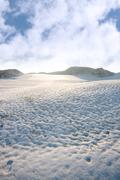 footprints on a slippery white snow covered course - stock photo