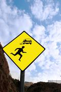 yellow diamond pedestrian warning sign - stock photo