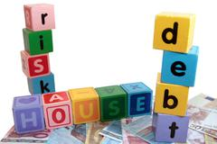 House debt risk in toy play block letters Stock Photos