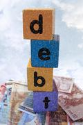 stormy debt in play letters - stock photo