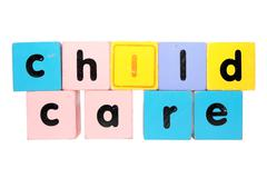 childcare  in toy play block letters with clipping path - stock photo