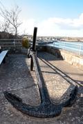 anchor on display in irish seaside town - stock photo
