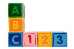 abc 123 in wood block letters with clipping path - stock photo