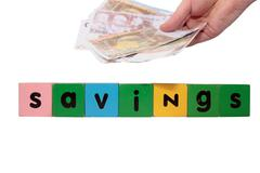 Money savings in toy letters Stock Photos