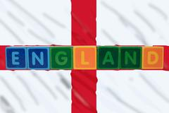 England and flag in toy block letters Stock Photos